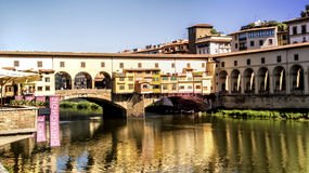 Italy,Florence, Ponte Vecchio and gallery Uffizi. Italy,Tuscany,Florence,Ponte Vecchio bridge,view across the river Arno to the Uffizi gallery stock photography