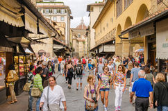 ITALY FLORENCE. SEP 4, 2014: people walk on the famous Ponte Vecchio one of Florence's oldest and most photographed bridges Stock Photos