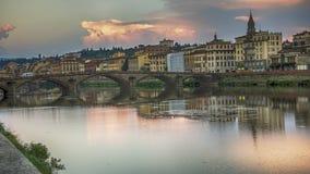 Italy,Florence View across Arno river. Italy,Florence,Firenze,Santa Trinita bridge at the sundown royalty free stock photo