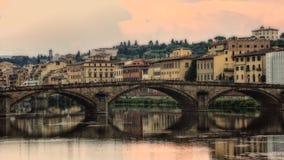 Italy,Florence View across Arno river. Italy,Florence,Firenze,Santa Trinita bridge at the sundown stock photo