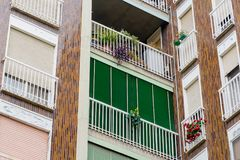 Green Building with balconies lined for offices and homes. fragment green balcony in a building stock photography