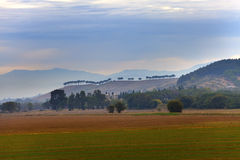 Italy. Green fields and mountains in morning fog Royalty Free Stock Images