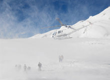 Italy. Helicopter takes the ski free-ride team Royalty Free Stock Photo