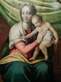 italy Konstnärligt arv MadonnasänkaBambino, madonna och barn, arbete av Giovan Filippo Criscuolo royaltyfria bilder