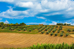 Italy landscape view with clouds on blue sky, Italian fields. Stock Photos