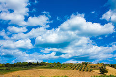 Italy landscape view with clouds on blue sky, Italian fields. Royalty Free Stock Photo