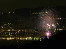 Italy, Liguria, Ventimiglia, artificial fires, in the background the lights of Monte Carlo royalty free stock images