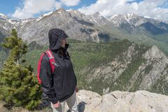 Italy, Liguria, Young woman hiking on mountain royalty free stock photography