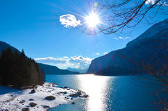 Italy, molveno lake. View of lake Molveno with the sun reflected on it Royalty Free Stock Images