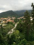 Italy. Mountains river clouds village Royalty Free Stock Images