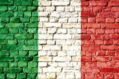 Italy national flag painted on a brick wall with the traditional green, white and red colors. Stock Photo