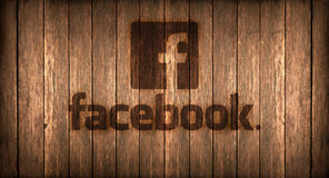 Italy, november 2016 -  Facebook logo printed on fire on a wood. Logo of a famous social networks printed on fire on a wooden board Stock Image