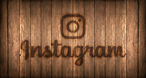 Italy, november 2016 -  Instagram logo printed on fire on a wood. Logo of a famous social networks printed on fire on a wooden board Stock Photography