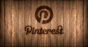 Italy, november 2016 -  Pinterest logo printed on fire on a wood. Logo of a famous social networks printed on fire on a wooden board Stock Photos