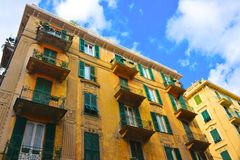 Savona Green-Iron Balconies and Yellow Building, Picturesque Neighborhood, Travel Italy. Italy, November, 2017 - Savona yellow building and green-iron balconies Royalty Free Stock Photos