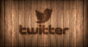 Italy, november 2016 -  Twitter logo printed on fire on a wood Royalty Free Stock Photography
