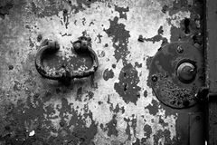 Italy: An old wood door with cracked red paint and grunge Royalty Free Stock Images