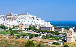 Ostuni, a white village between the olive grove. Italy, Ostuni, panoramic view of the white village royalty free stock images