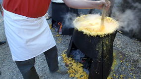 Italy, outdoor cooking polenta. Stock Photography