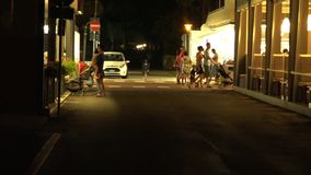 Italy. People walk the streets at night. HD stock footage