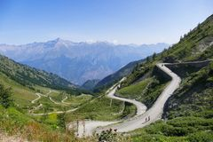 Group of vintage motorbike riders. Italy Piedmont Alps circa June 2015 Group of vintage motorbike rider layover rear view in mountain high pass landscape Stock Images