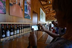 Italy, Piedmont, Langhe, wine tourists at `Cascina Monfalletto`. Italy, Piedmont, Langhe, circa August 2016, wine tourists at `Cascina Monfalletto stock photo