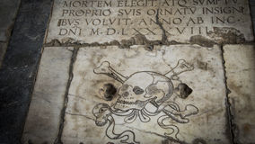 Italy,Pisa,Camposanto floor with Skull 3. Italy,Pisa, Camposanto Floor,Grave with Skull on marble 3 royalty free stock images