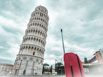 Italy Pisa tower with red suitcase Stock Image