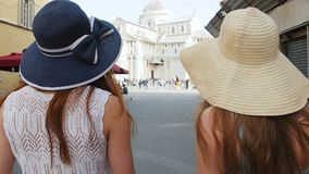 Italy, Pisa. Two young women walking on the streets. Mid shot stock footage