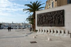 Italy, Puglia, Bari, Trani, monument dedicated to the `Maritime Statutes`. Italy, Puglia, Bari, Trani, monument built in bas-relief dedicated to the `Maritime Royalty Free Stock Images