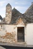 Italy-Puglia-Traditional home abandoned. Europe-Italy-Puglia-Traditional home and flowers royalty free stock photo