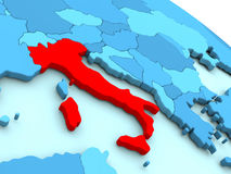 Italy in red on blue globe Royalty Free Stock Photos