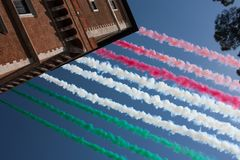 Italy Republic Day 2018 tricolor smoke trails. Italy Republic Day Military Parade June 2, 2018: Tricolor smoke trails left by jets above Piazza Venezia in Rome Royalty Free Stock Image