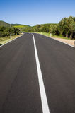 Italy. Road markings. The solid white line, dividing the road into two lanes with different directions of traffic Royalty Free Stock Photo