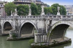 Italy. Rome. The bridge with sculptures over River Tiber to castle Saint Angelo Stock Image