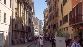 Italy, Rome - Circa May 2018: Italian street with cafes and shops. People tourists walking around stock footage