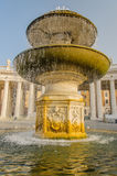 Italy - Rome - City Centre. Fountain in front of the historical Saint Peter Catherdral located on Saint Peter Square at Vatican City at the beginning of the Royalty Free Stock Photography