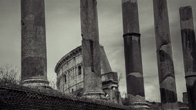 Italy,Rome, Colonnade of Forum. And the Collosseum royalty free stock images