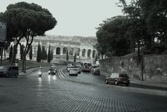 Italy, Rome, Colosseum, traffic... Trip to Europe: Italy, Rome, Colosseum. Evening traffic on the road leading to the Coliseum: motorcycles, cars, buses...All Royalty Free Stock Photography