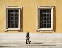 Woman with a dog walking along the ancient streets, photo for postcard