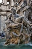 Fountain of the Four Rivers in the background the church Sant Agnese in Piazza Navona in Rome Royalty Free Stock Photos