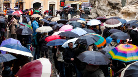 Italy, Rome - September 2016: Crowd with umbrellas is standing near Trevi fountain. Royalty Free Stock Images