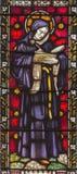 italy rome 2016: Sten Beda Venerabilis på målat glass allra Saints& x27; Anglikansk kyrka vid arbetsrummet Clayton och Hall Arkivbild