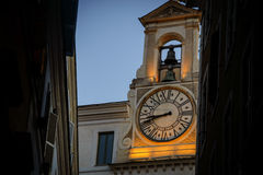Italy,Rome,tower clock and the bell. Italy,Rome,Trastevere, tower clock and the bell near Campo di Fiori royalty free stock image