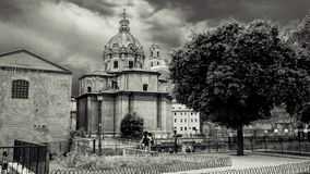 Italy,Rome, Trajan's Forum and the church. Italy,Rome, Forum Traiano (Trajan's Forum)with the little square and the church royalty free stock photos
