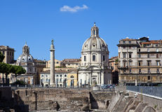 Italy. Rome. Trojan column, churches of Santa Maria di Loreto and Santissima Nome di Maria (Most Holy Name of Mary ),and ruins of Stock Photography