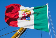 The naval flag of Italy flutters on the mast. Italy`s naval flag flying on a sailboat mast royalty free stock photo