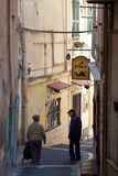 ITALY SANREMO - MAY 5, 2017 two senior men down a alley Stock Images