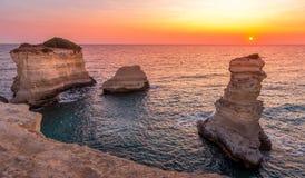 Italy, Santo Andrea cliffs in Puglia. Meledugno town in Italy, Puglia Region. Spectacular view at sunrise on Santo Andrea cliffs Stock Photos