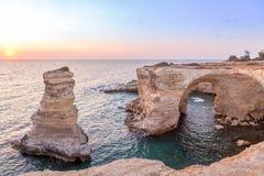 Italy, Santo Andrea cliffs in Puglia. Meledugno town in Italy, Puglia Region. Spectacular view at sunrise on Santo Andrea cliffs Royalty Free Stock Photos